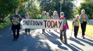Shut It Downers advance to the Vermont Yankee gate: from left - Ulrike Von Moltke, Paki Wieland, Nancy First, Hattie Nestel, Linda Pon Owens, Ellen Graves, Anneke Corbett and Frances Crowe.  Photo by Marcia Gagliardi