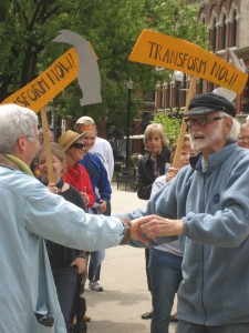Bix dancing before the start of the Transform Now Plowshares trial in Knoxville, May 2013.  Photo by Felice Cohen-Joppa