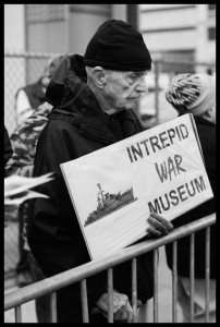 Dan Berrigan protesting the rededication of the Intrepid war museum aircraft carrier on the west side of Manhattan, Nov. 2008. Photo: Ed Hedemann