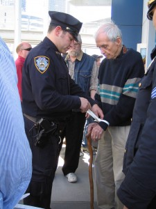 "photo by Ananda Strazzini: Dan's last arrest, Good Friday, at the ""USS Intrepid"" Museum, 2 April 2011"