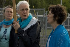 The Grady sisters, (L-R) Ellen, Teresa and Clare, protest in Seneca Lake. (Photo: Nicholas Kusnetz)