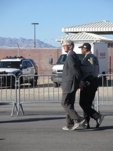Catholic Worker archivist Phil Runkel being taken into custody at Creech drone base, photo by Felice Cohen-Joppa