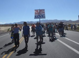 Catholic Workers process to the gate of the Nevada National Security Site (nuclear test site), photo by Felice Cohen-Joppa