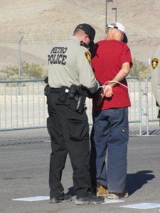 Scott Schaeffer-Duffy arrested at Creech drone base, photo by Felice Cohen-Joppa