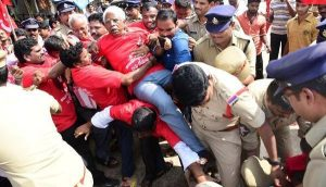CPI(M) leader Ch. Narasinga Rao being taken into custody at Kosta junction in Srikakulam district on Sunday.— Photo: Basheer